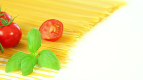 Spaghetti tomatoes and basil, italian food background stock footage