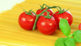 Spaghetti tomatoes and basil, italian food background stock video
