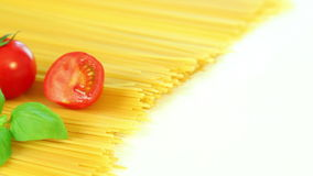 Spaghetti tomatoes and basil, italian food background stock video footage