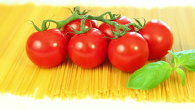 Spaghetti tomatoes and basil stock footage