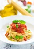 Spaghetti with tomatoes Stock Photos