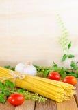 Spaghetti ,tomatoes, garlic and herb Stock Photos