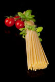 Spaghetti, tomatoes and herbs. Royalty Free Stock Image