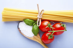 Spaghetti and tomatoes with herbs Stock Image