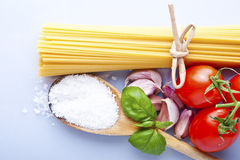 Spaghetti and tomatoes with herbs Stock Images