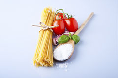 Spaghetti and tomatoes with herbs Royalty Free Stock Photo