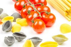 Spaghetti and tomatoes with herbs Stock Photography