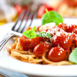 Spaghetti with tomatoes and parmesan Royalty Free Stock Image