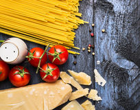 Spaghetti with tomatoes and parmesan on blue wooden background, top view Stock Photo