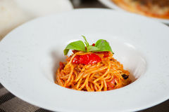 Spaghetti with Tomatoes. In Plate on table Royalty Free Stock Photos