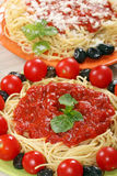 Spaghetti with tomatoes and sauce Stock Images