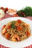 Spaghetti with tomatoes and shrimp Stock Photography