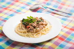 Spaghetti topped with stir-fried pork. And basil Royalty Free Stock Photo