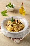 Spaghetti with tuna, capers and black olives Stock Photos