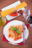 Spaghetti with tuna, cherry tomatoes and capers. Stock Photography