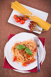 Spaghetti with tuna, cherry tomatoes and capers. Stock Image