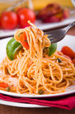 Spaghetti with tuna, cherry tomatoes and capers. Stock Images