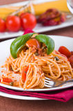 Spaghetti with tuna, cherry tomatoes and capers. Royalty Free Stock Images