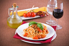Spaghetti with tuna, cherry tomatoes and capers. Stock Photo