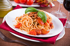 Spaghetti with tuna, cherry tomatoes and capers. Stock Photos