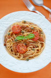 Spaghetti with tuna and tomatoes sauсe Stock Images