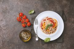 Spaghetti with tuna and tomatoes Stock Images