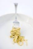Spaghetti Twirl. Spaghetti with Pesto Sauce Twirled on a Fork Royalty Free Stock Images