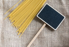 Spaghetti uncooked and small blackboard Stock Photos