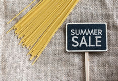 Spaghetti uncooked and summer sale drawing on blackboard Stock Photos