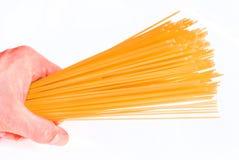 Spaghetti V4. Many spaghetti in one hand on a white background Stock Photo