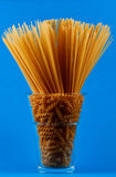 Spaghetti in vase. On blue background Stock Images