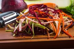 Spaghetti of Vegetables. Carrot, Zucchini and beet Noddles royalty free stock photography
