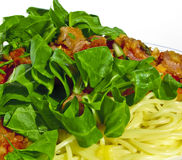 Spaghetti with Vegetables and Lettuce. A macro shot of delicious pasta dish with vegetables and lettuce Royalty Free Stock Image