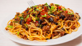 Spaghetti with vegetables and minced meat Stock Photos