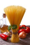 Spaghetti, vegetables and olive oil on the table isolated Stock Photo
