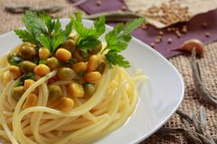 Spaghetti with vegetables and parsley Stock Image