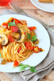 Spaghetti with vegetables on a white plate Royalty Free Stock Photography