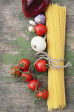 Spaghetti and vegetables on wooden background Royalty Free Stock Photography
