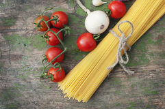 Spaghetti with vegetables on wooden background Stock Image