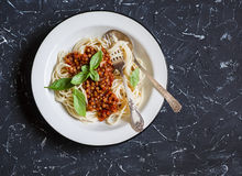 Spaghetti with vegetarian lentil bolognese on a dark background. Royalty Free Stock Image