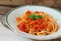 Spaghetti with vegetarian sauce. Spaghetti with carrot and tomato sauce Stock Images