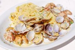 Spaghetti vongole in the italian trattoria. Royalty Free Stock Image