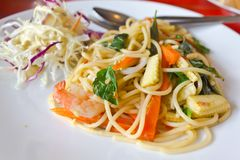 Spaghetti whit shrimp and basil fried Stock Photos