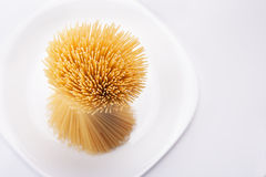 Spaghetti on white plate. Bunch of Spaghetti on white plate Royalty Free Stock Images