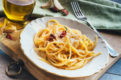 Spaghetti on white plate. Olive oil, garlics and chilli Stock Images