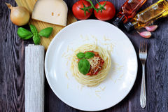 Spaghetti on white plate with pasta and tomatoes Royalty Free Stock Image
