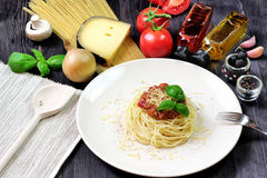 Spaghetti on white plate with pasta and tomatoes Royalty Free Stock Images