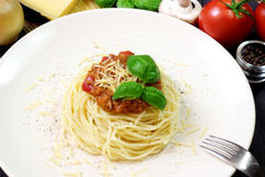 Spaghetti on white plate with pasta and tomatoes Royalty Free Stock Photography