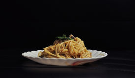 Spaghetti with white sauce on black background Royalty Free Stock Photo