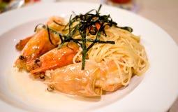 Spaghetti white sauce with giant river prawn. Served on white plate Royalty Free Stock Photo